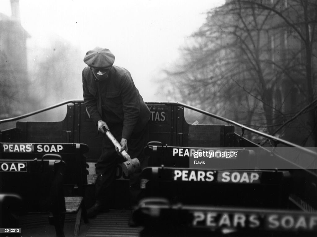 A man spraying the top of a bus with an anti-flu virus during an epidemic which followed World War I.