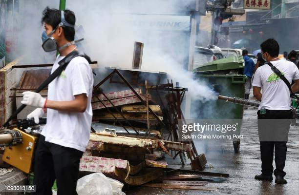 Man sprays disinfectants on Rua de Cinco De Outubro after Typhoon Hato and Pakhar hit over the past week. 28AUG17 SCMP / Nora Tam