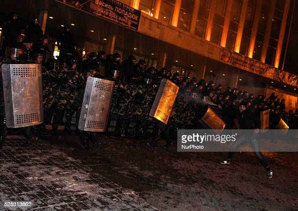 A man spreads the tear gas towars the towards the police holding the cordon around concert hall Unknown people tried to disrupt Ani Lorak concert in...