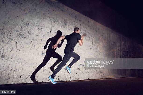 Man sprinting at night