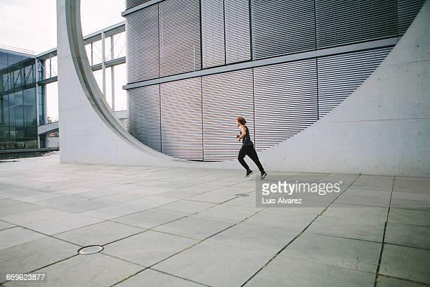 Man sprinting through the city