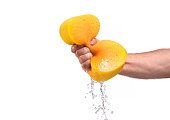 strong man squeezing sponge with water