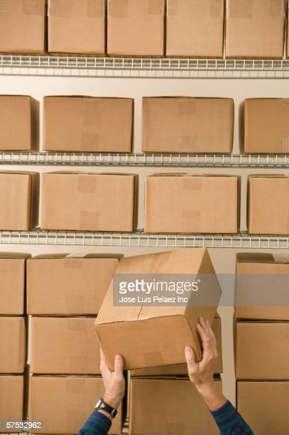 man stacking cardboard boxes - positioning stock pictures, royalty-free photos & images