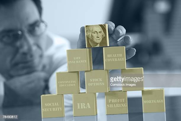 Man stacking financial blocks