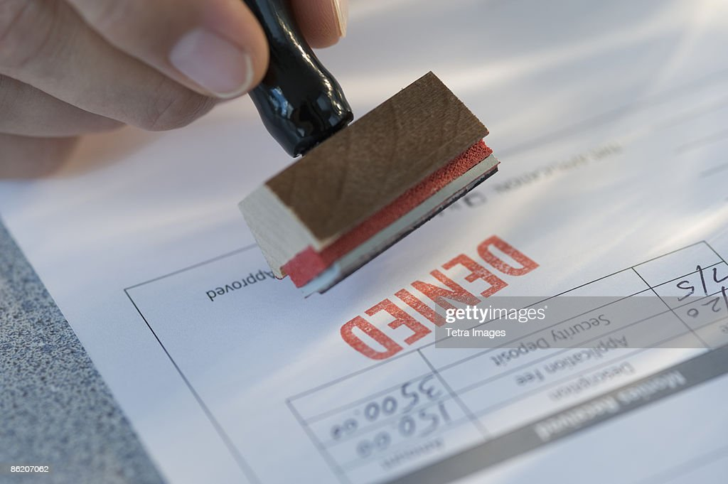 Man stamping denied on mortgage application : Stock Photo