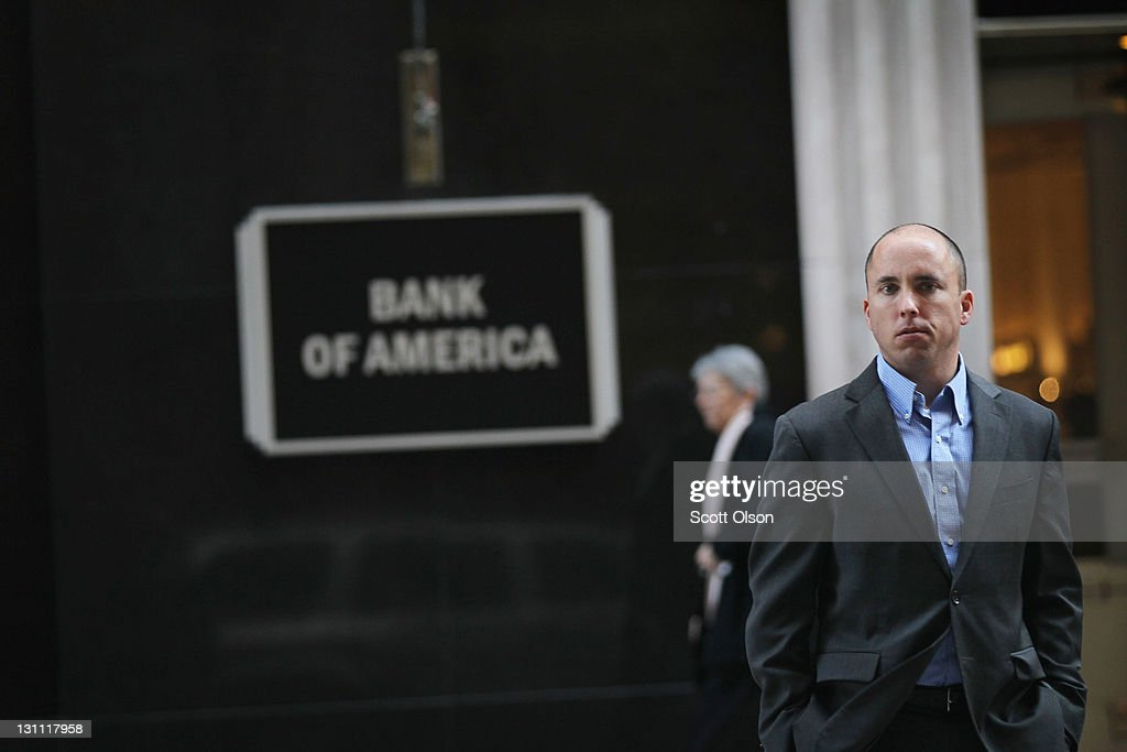 A man stand in front of a Bank of America branch in the Financial District on November 1, 2011 in Chicago, Illinois. Bank of America Corp. has reportedly announced they will drop its plan to charge customers a $5-per-month fee for making purchases with their debit cards.