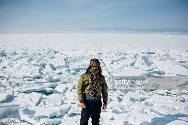 A man stand in front of block of ices