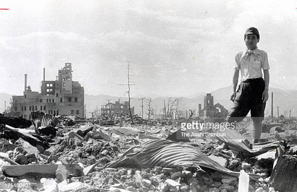 A man stand on the debris after the atomic bomb completely destroyed the city in August 1945 in Hiroshima Japan The world's first atomic bomb was...