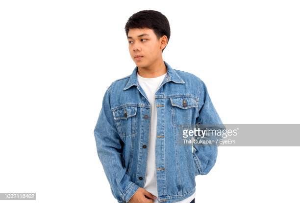 man standing against white background - denim jacket stock pictures, royalty-free photos & images
