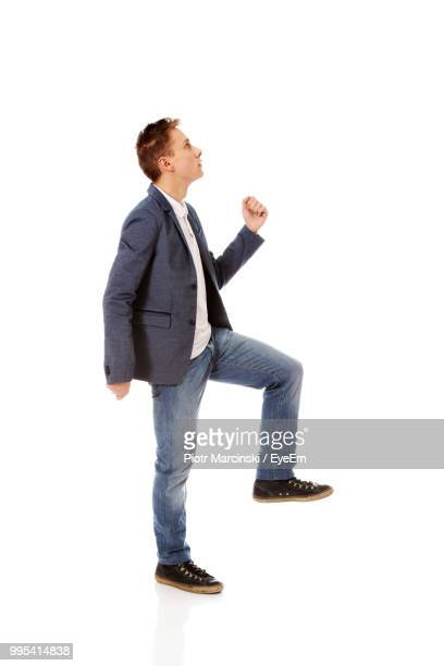 Man Standing Against White Background