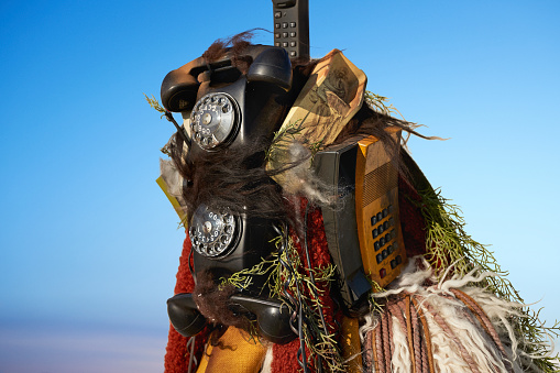 Man standing alone, wearing amazing costume - made out of old phones - gettyimageskorea