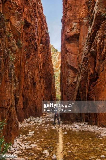 Man Standing Amidst Rock Formation