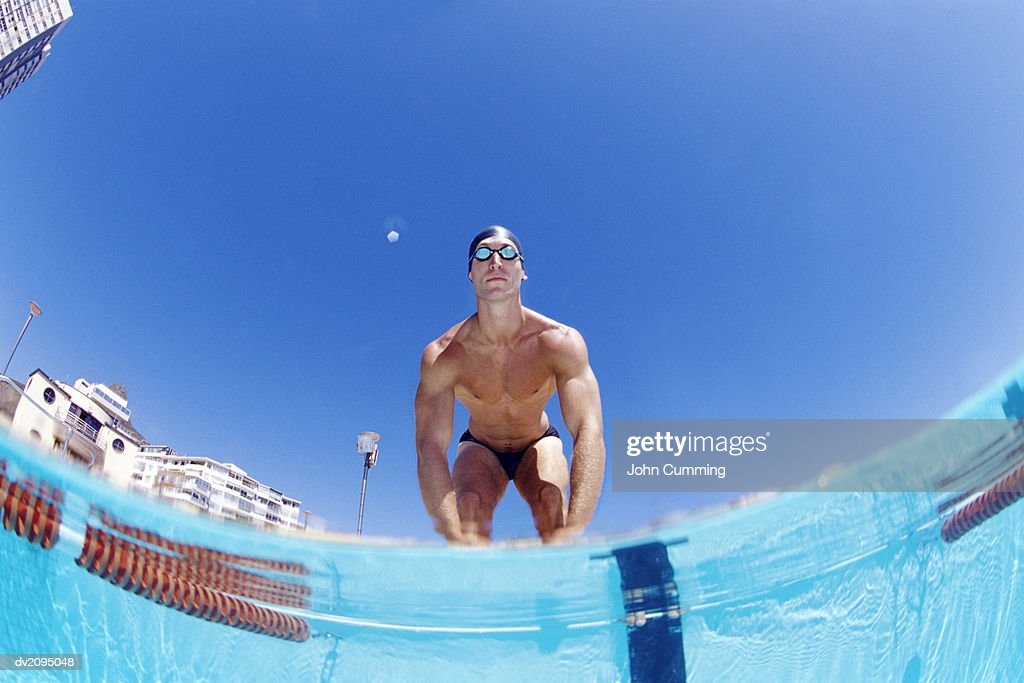 Man Standing at a Poolside : Stock Photo