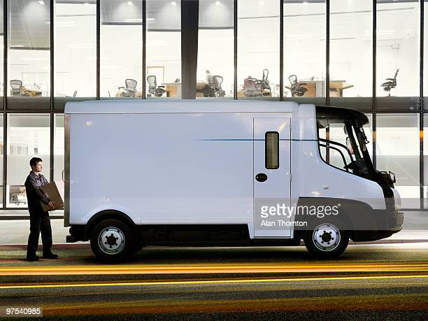 man standing at back of electric van - caucasian ethnicity stock pictures, royalty-free photos & images