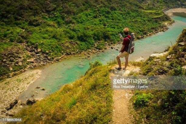 man standing at beach - pokhara stock pictures, royalty-free photos & images