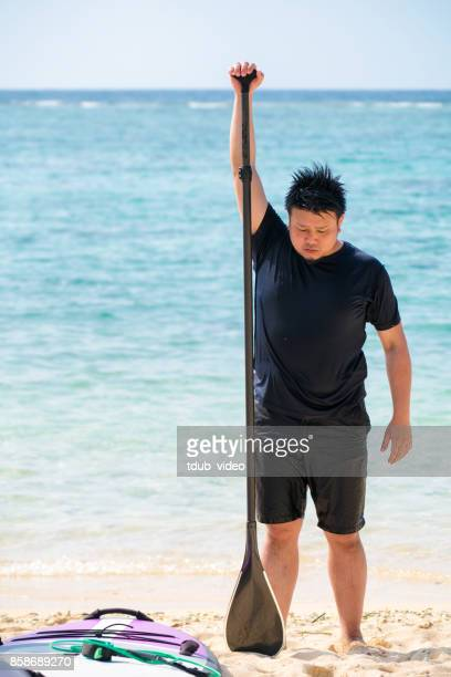 Man standing at Okinawa beach