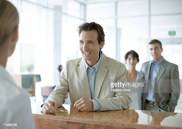 Man standing at reception desk