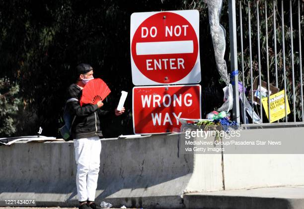 Man standing at the 210 Freeway Fair Oaks Ave. Selling fans and masks due to the Coronavirus Pandemic in Pasadena on Wednesday, April 22, 2020.