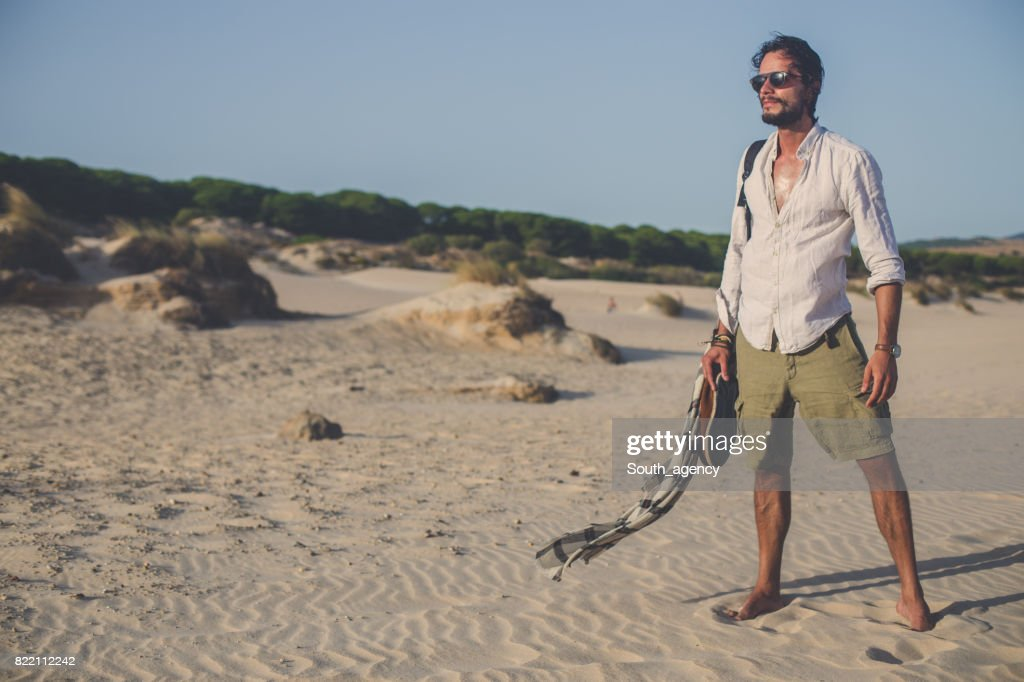 Man standing at the beach : Stock Photo