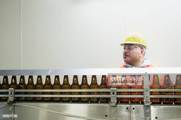 Man standing behind conveyor belt
