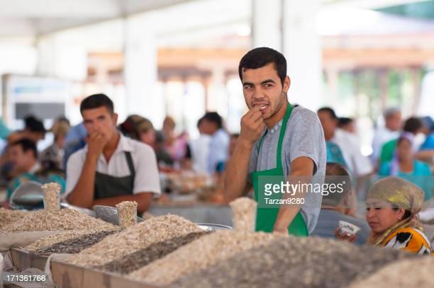 Man standing behind his food stand in Siob Bazaar, Samarkand