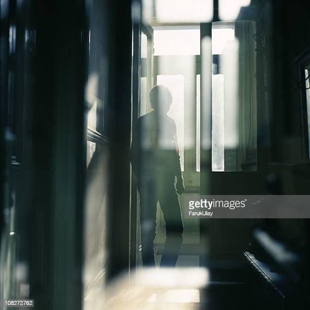 Man Standing between Doors
