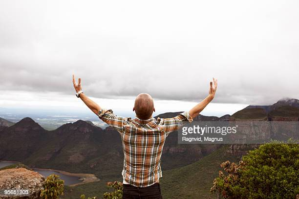 Man standing by a canyon, South Africa.