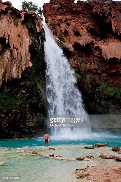 Man standing by Havasupai Falls near Grand Canyon National, Arizona, USA