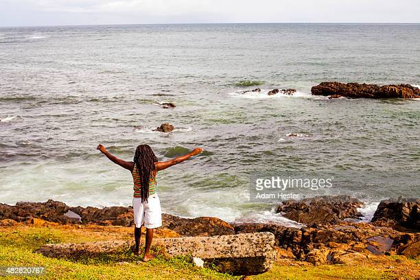 a man standing by himself next to the atlantic. - rasta photos et images de collection