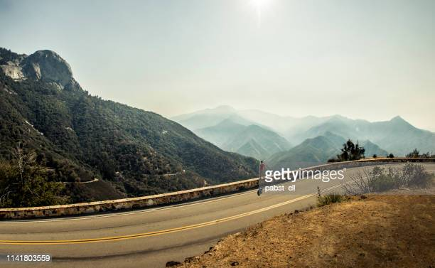 man standing by the road at sequoia national park - southern european descent stock pictures, royalty-free photos & images