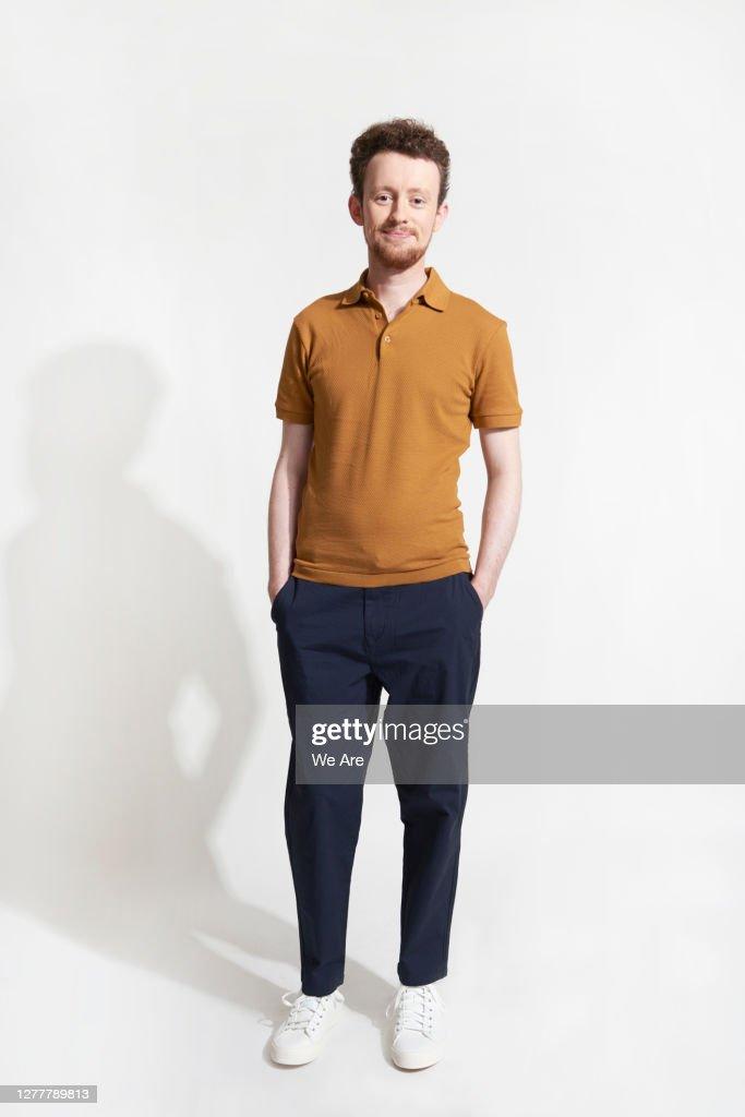 Man standing casually looking at camera : Stock Photo