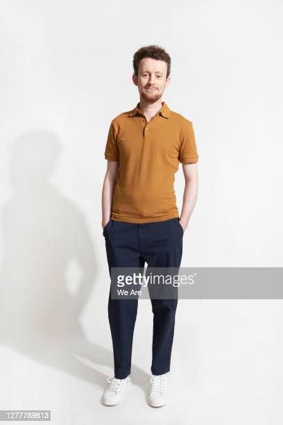 man standing casually looking at camera - young adult stock pictures, royalty-free photos & images