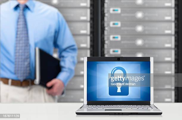 Man standing close to a laptop showing a lock sign