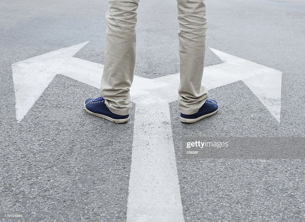 Man standing hesitating to make decision : Stock Photo