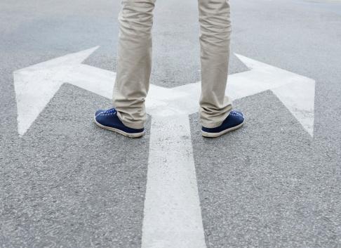 Man standing hesitating to make decision 170104934