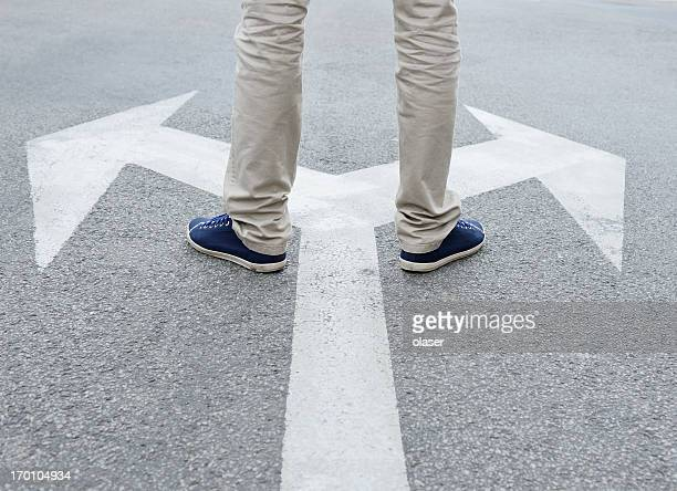 man standing hesitating to make decision - beslissingen stockfoto's en -beelden