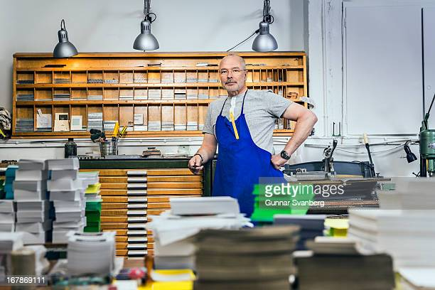 Man standing in a old printing company