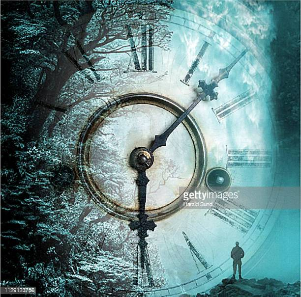 Man standing in a scene with a vintage antique grandfather clock face with Roman numeral numbers and hour and second hands in a fantasy, surreal, dreamlike forest.