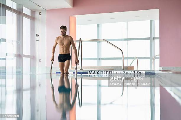 Man standing in a swimming pool