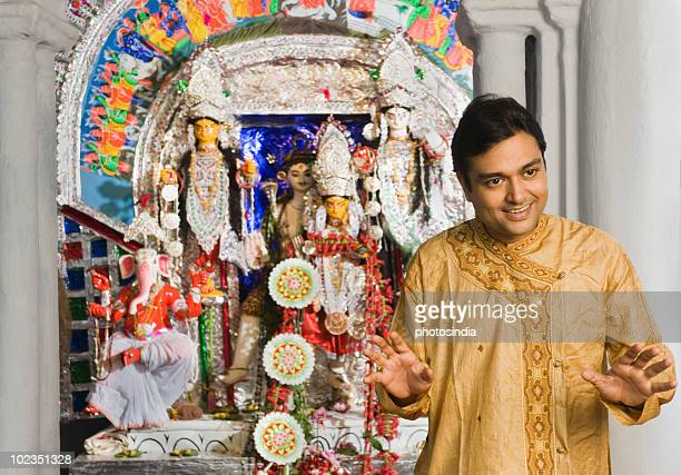 man standing in a temple - laxmi ganesh stock pictures, royalty-free photos & images
