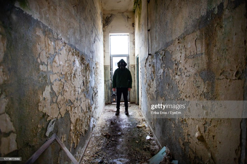 Man Standing In Abandoned Building High Res Stock Photo Getty Images