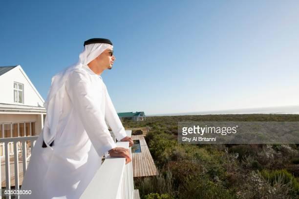 Man standing in balcony