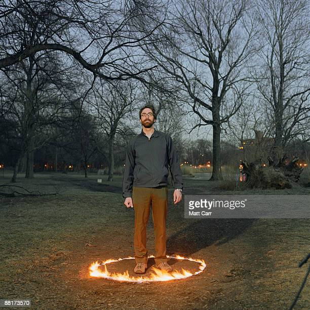 Man standing in circle of fire