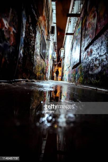 Man standing in dark alley - Florentin, Tel Aviv, Israel