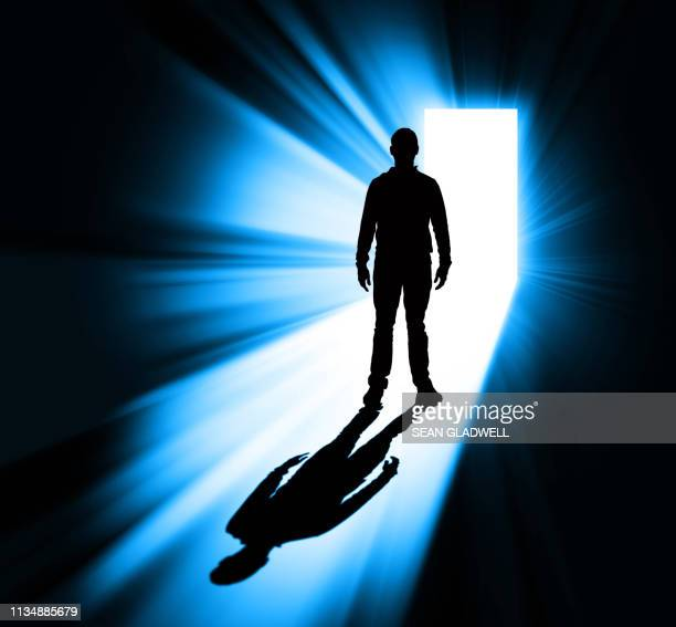 man standing in doorway silhouette - electric light stock pictures, royalty-free photos & images