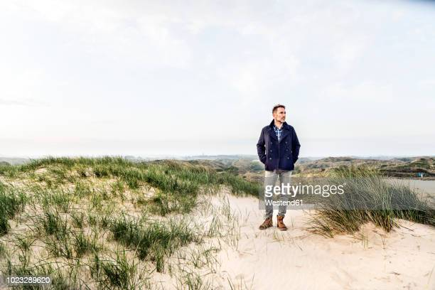man standing in dune landscape - full length stock pictures, royalty-free photos & images