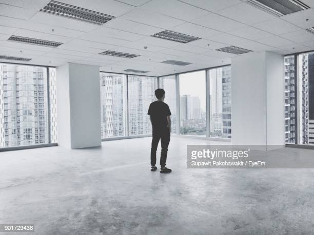 man standing in empty room - one man only stock pictures, royalty-free photos & images
