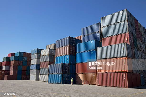 Man standing in front of containers