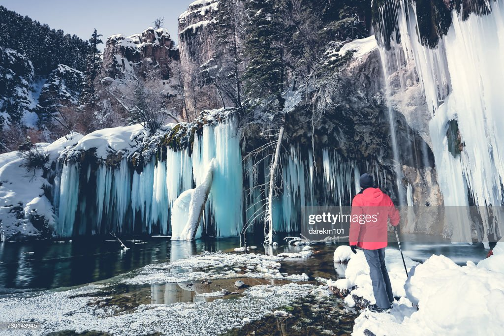 Man standing in front of frozen waterfall, Hanging lake, Colorado, America, USA : Stock Photo