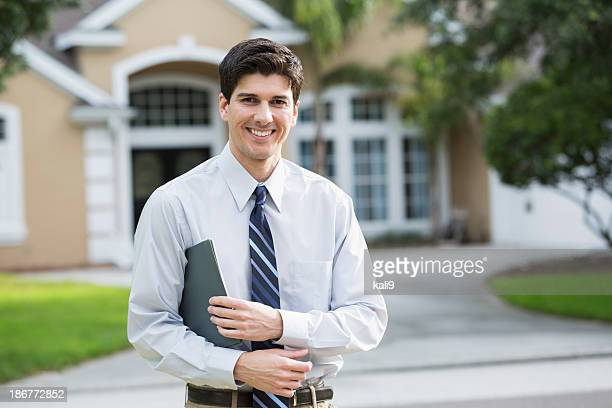 Man standing in front of house